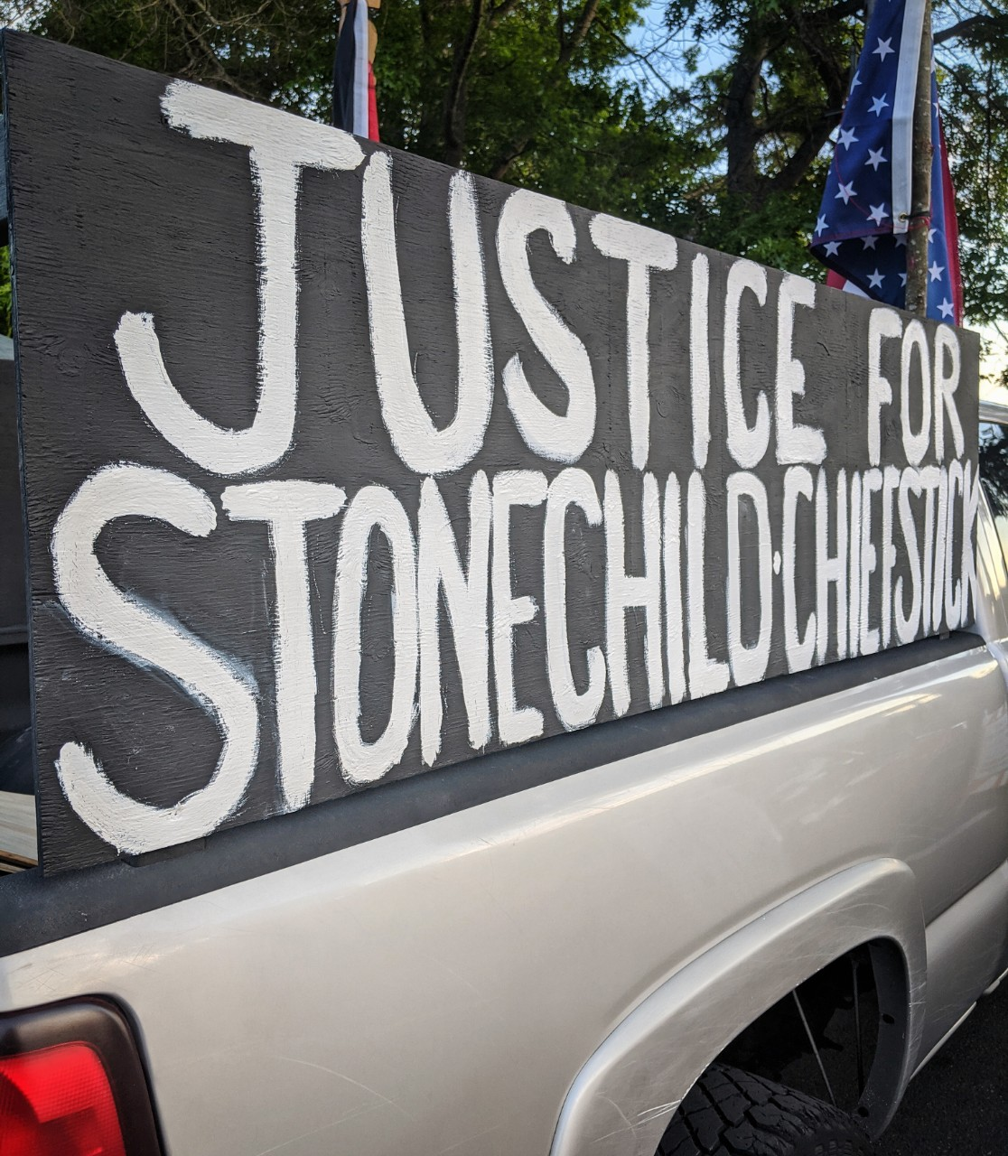 Justice for Stonechild Chiefstick sign on a truck