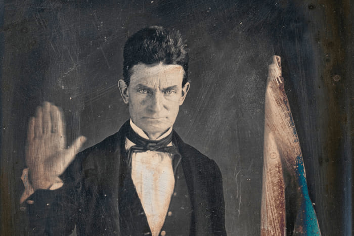 John Brown holding up his hand. Rest in Power, Will!